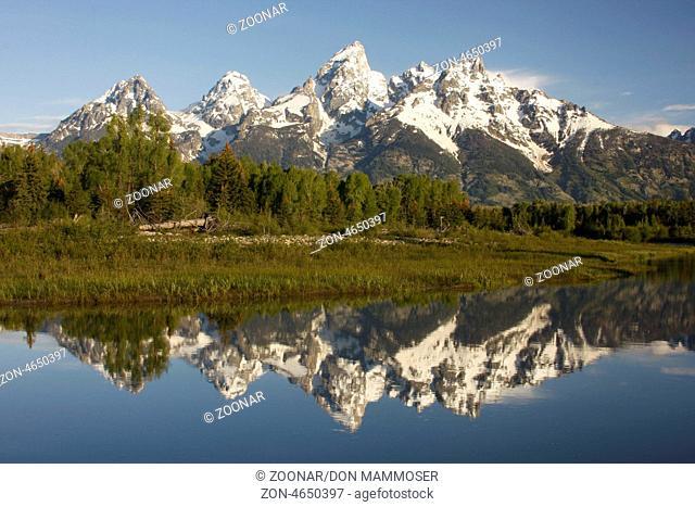 Mountains reflected into Snake river, Grand Teton National Park, Wyoming, USA