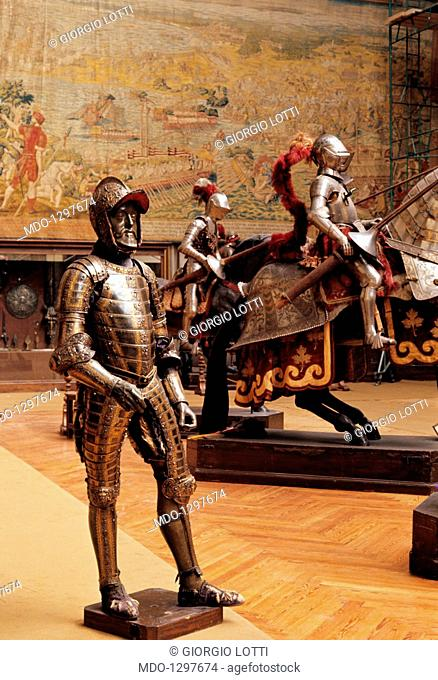 A room of the Royal Armoury in Madrid. Close-up of a the whole magnificent, lavishly decorated armour of Philip II, first King of Spain from 1556 to 1598