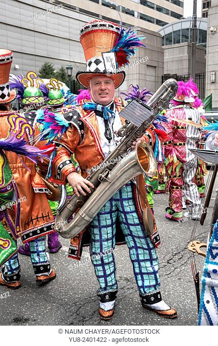 Saxophonist in bright carnival costume, String band musicians, St. Patrick's Day Parade, Philadelphia, PA, USA