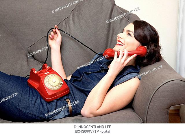 Woman on sofa on the phone