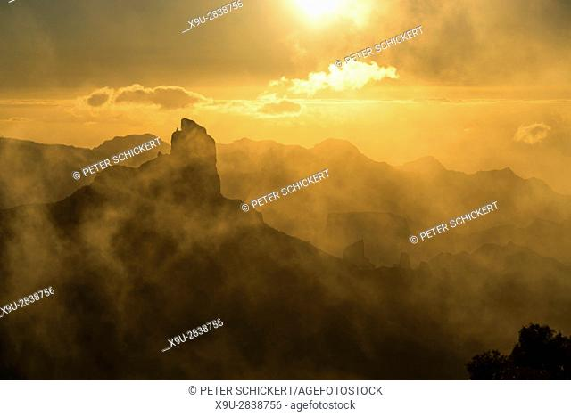 foggy landscape around the Monolith Roque Bentayga at dusk, Gran Canaria, Canary Islands, Spain