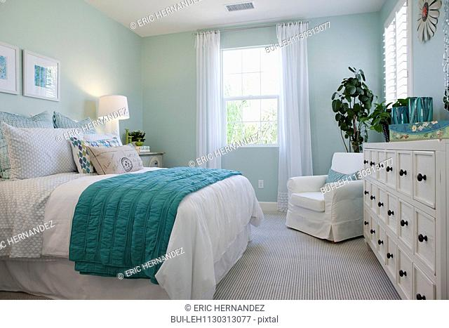 Bed and drawers in bedroom