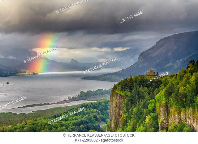 A view down the Columbia River gorge with a rainbow near sunset, Oregon, USA