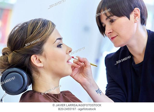 Make-up artist applying lip liner on customer. Hairdressing salon and Beauty Clinic