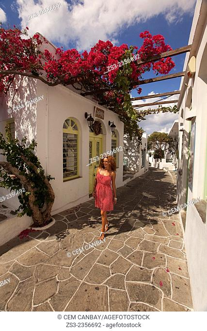 Woman walking in the street of Apollonia village, Sifnos, Cyclades Islands, greek Islands, Greece, Europe