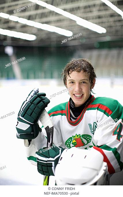 Portrait of a teenager playing hockey, Sweden