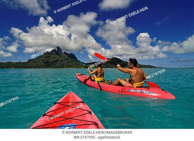 Tourists in a kayak, St. Regis Bora Bora Resort, Bora Bora, Leeward Islands, Society Islands, French Polynesia, Pacific Ocean