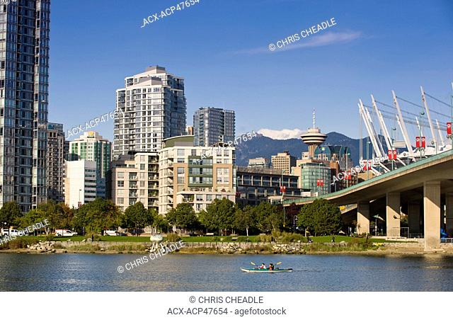 Kayakers and Cambie Bridge, city skyline with new retractable roof on BC Place Stadium, False Creek, Vancouver, British Columbia, Canada