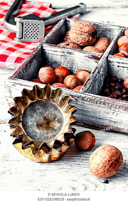 kitchen table with baking dish and a box with walnuts and hazelnuts