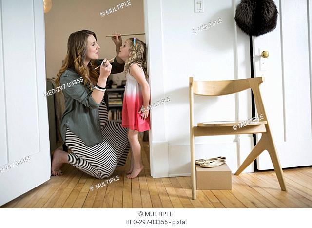 Mother measuring daughter