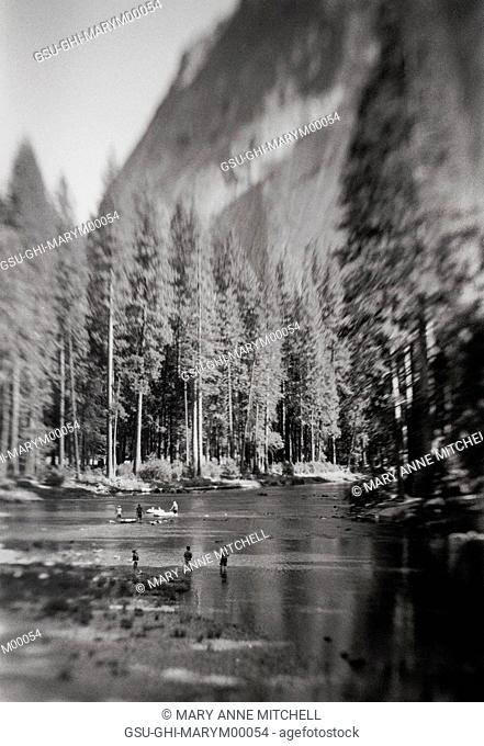 People Wading in Forest Lake, Yosemite National Park, California, USA