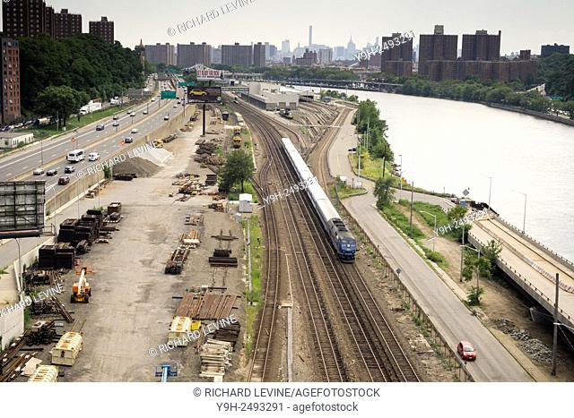 A Metro-North commuter train travels next to the Harlem River in the Bronx in New York