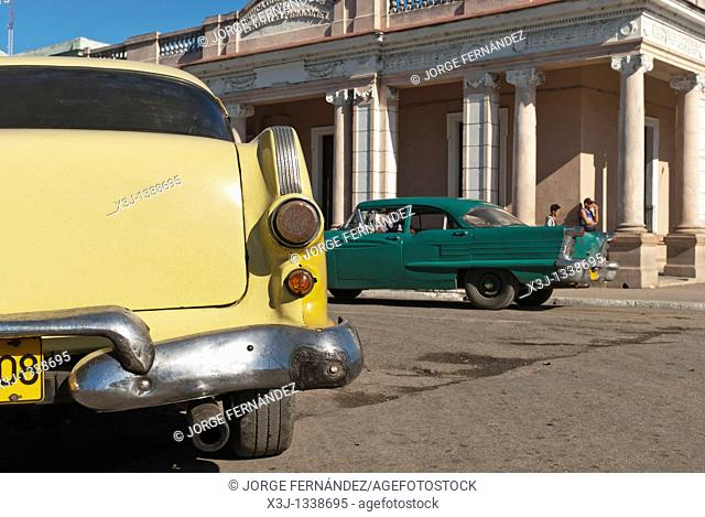Old cars in the square of Palmira, Cienfuegos, Cuba