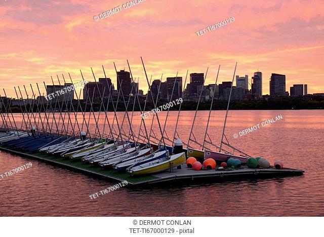 Sailboats on dock Charles River Boston at dawn