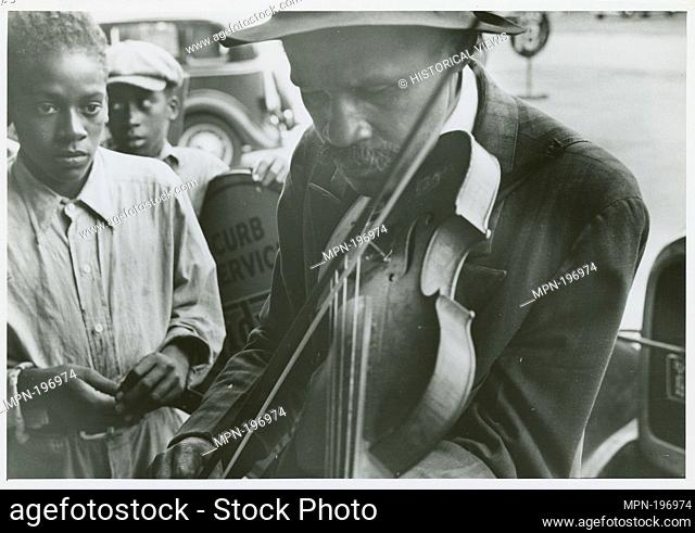 Blind street musicians, West Memphis, Arkansas, Sept. 1935. Additional title: [An African American man playing the violin.]. United States
