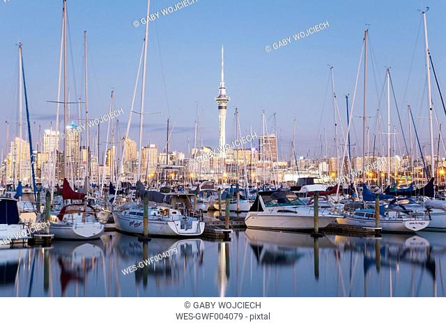 New Zealand, Auckland, Westhaven Marina, Skyline with Sky Tower, blue hour