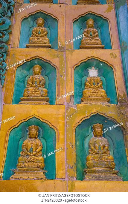 small buddhists, one damaged, statues at temple at summer palace in beijing china