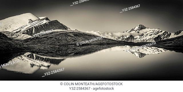 Mt Aspiring reflection in tarn, Cascade Saddle, Mount Aspiring National Park, Otago, New Zealand