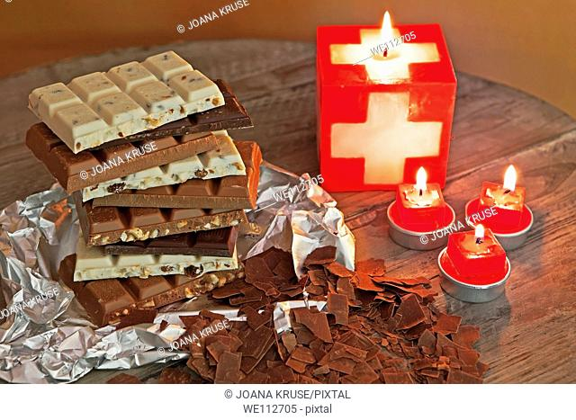 Swiss chocolate to create a tower stacked with swiss candles