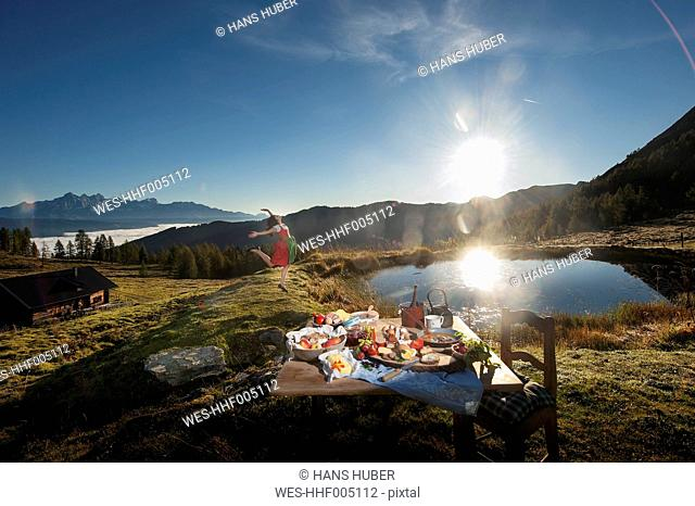 Austria, Salzburg State, Altenmarkt-Zauchensee, alpine pasture, breakfast at sunrise