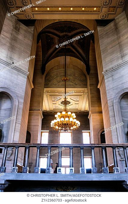 Looking up at the first floor balcony and the chandelier in the Tennessee State Capitol building in Nashville