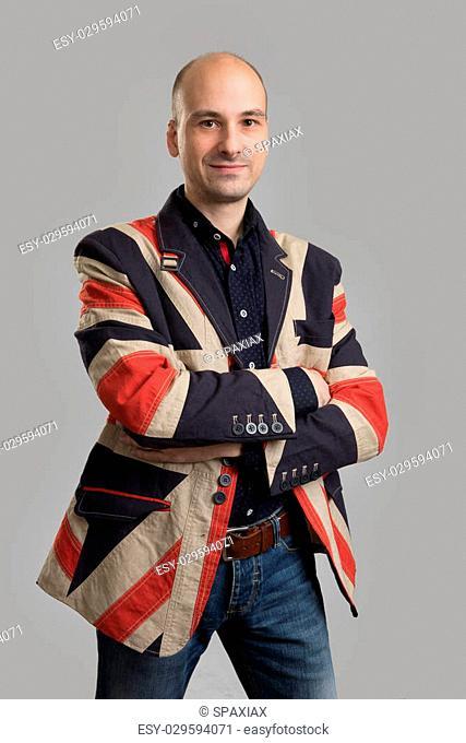 handsome bald man wearing fashionable jacket. Studio shot