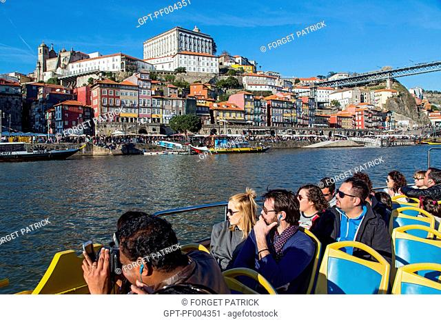 TOURISTS ON A BOAT ON THE DOURO, CITY OF PORTO, PORTUGAL