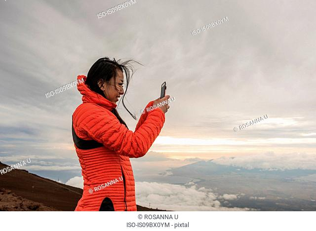 Woman taking photograph, Haleakala National Park, Maui, Hawaii