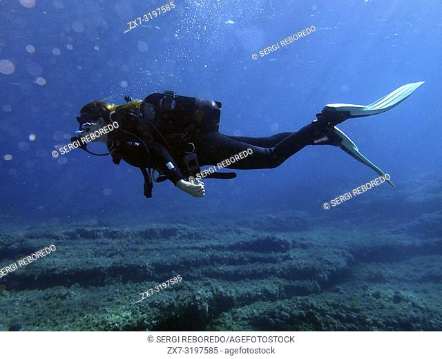 Diving in Arch area, Formentera, Balearic Islands, Mediterranean Sea, Spain. The Arch offers a rich, recreational seascape