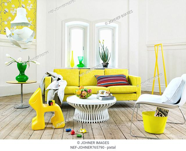 A light living room with yellow details, Sweden