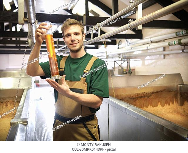 Worker with sample in fermentation room