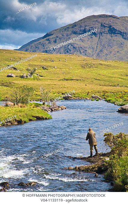 A man fishing in the Bundorragha River in Connemara, Ireland