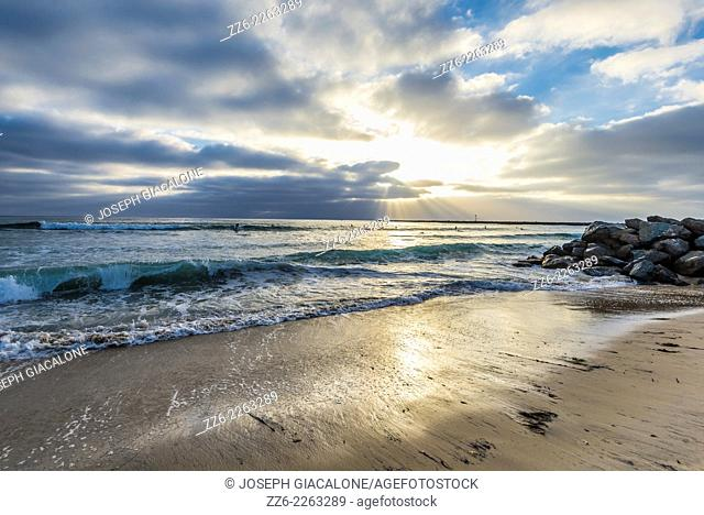 View of the ocean and clouds close to sunset from the Ocean Beach shoreline. San Diego, California, United States