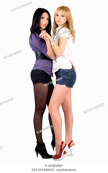 Two sexy young girlfriends. Isolated on white