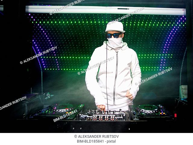 DJ playing music in nightclub