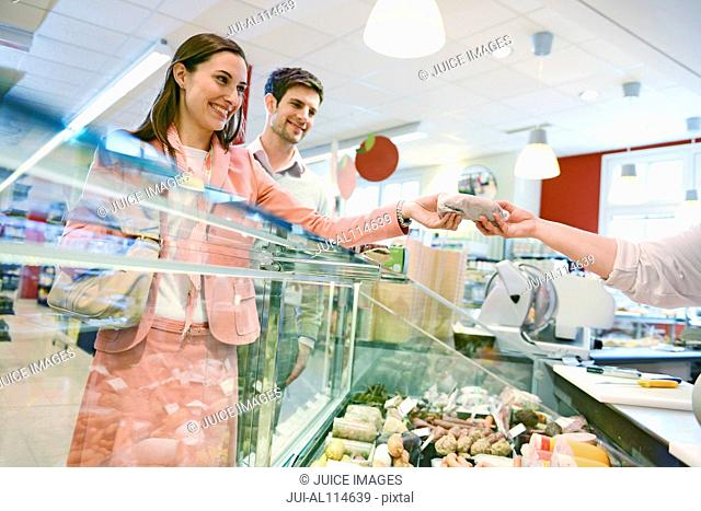 Customers shopping at the deli counter in organic grocery store