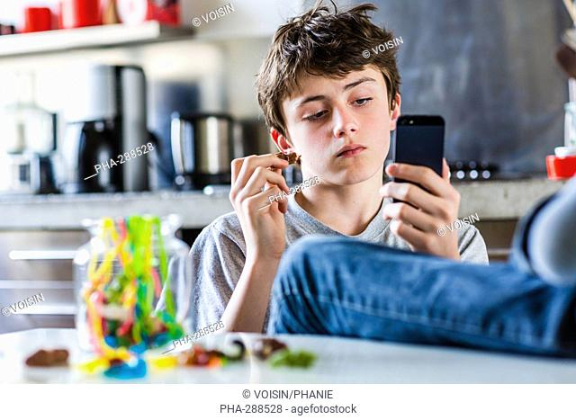 Teenage boy eating sweets