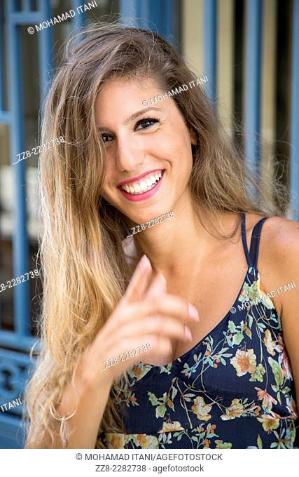 Happy young woman laughing