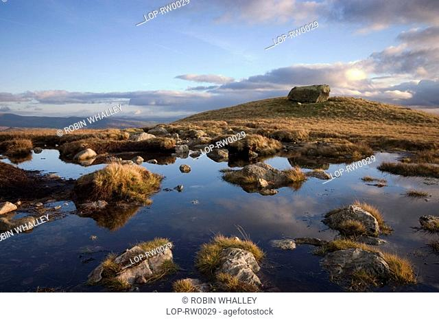 England, Cumbria, Langdale Pikes, Sky reflected in a pool. 'Once seen, never forgotten' wrote Alfred Wainwright, the Langdale Pikes are ever popular among...