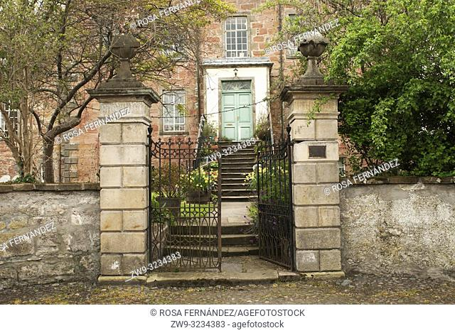 Entrance to a house with iron railings, stone stairs, trees and garden, Cromarty, Scotland, United Kingdom, Europe