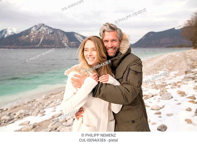 Portrait of couple beside lake, smiling, German Alps, Germany