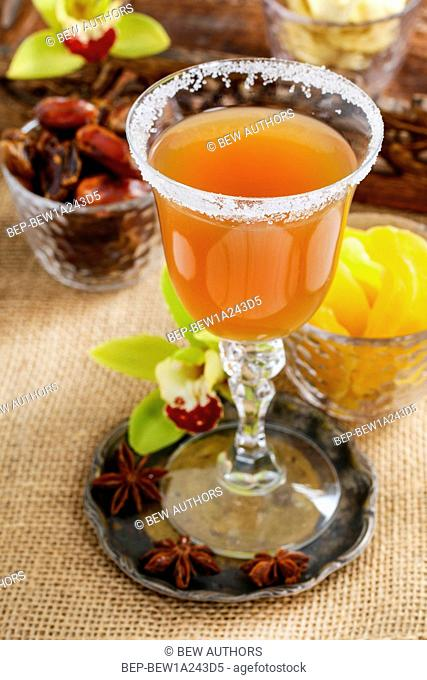 Sweet drink made of tropical fruits. Party dessert