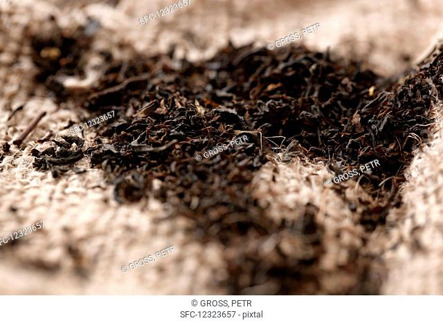 Black tea on a jute cloth (close up)