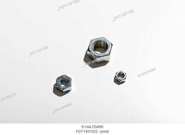 Close-up of bolts on white background