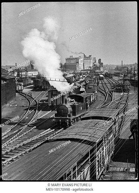 Steam goods trains at the busy shunting yard of Ipswich railway station, Suffolk, England