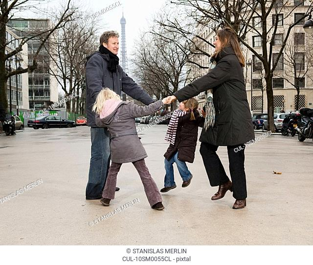 Family dancing near Eiffel Tower