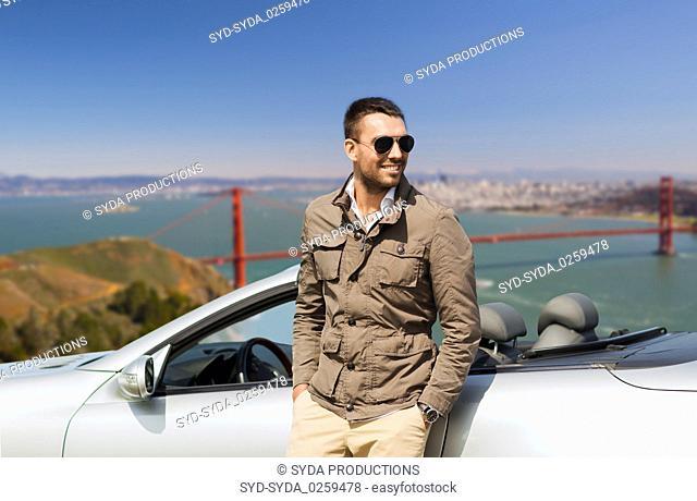 happy man near convertible car outdoors