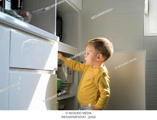 Little boy playing in the kitchen