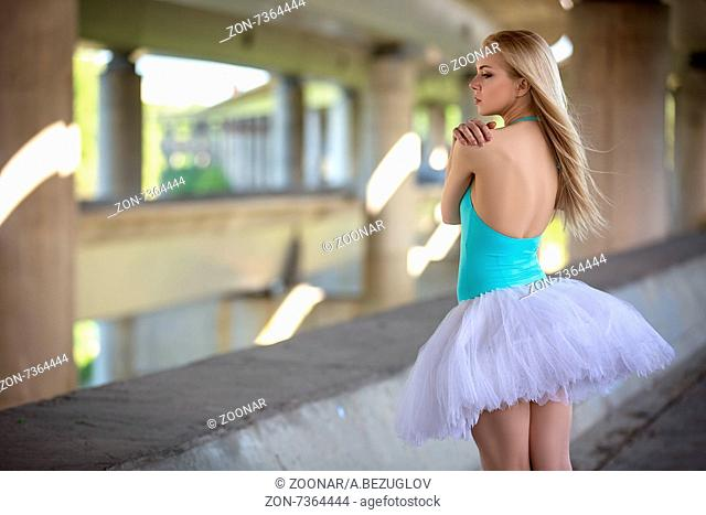 Graceful ballerina in the industrial background