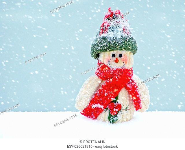 Merry Christmas postcard with a snowman in the snow